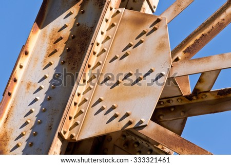 Steel Girders and Bolts, Rivets, Shadows and Rust - stock photo