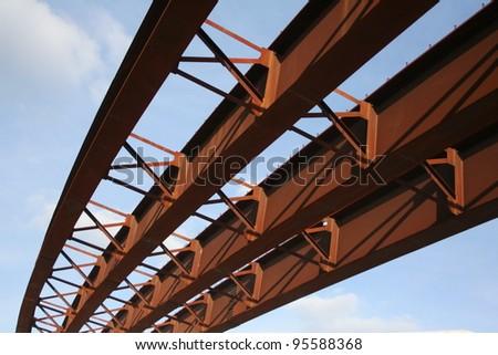 steel girders of highway overpass under construction - stock photo