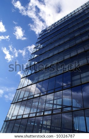 Steel & glass Commercial building wall in the cloudy sky