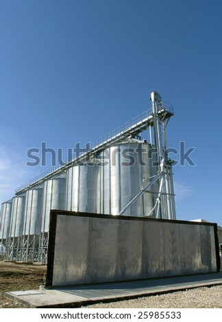 Steel granary against a blue sky