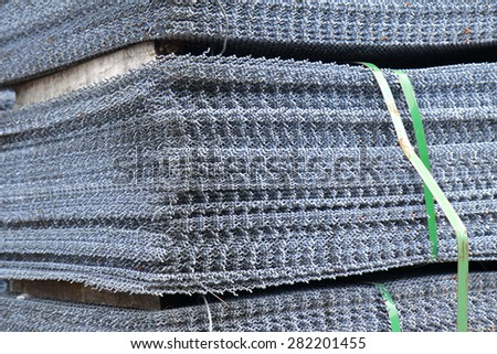 Steel grating bunch in warehouse for raw material - stock photo