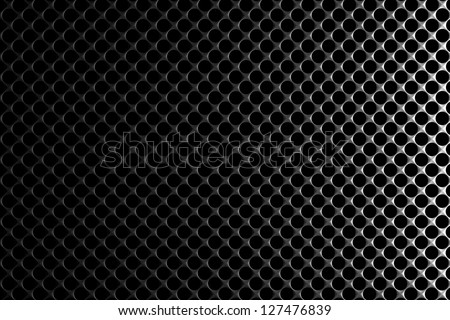 Steel grid with round holes and reflection on black background under the right straight light, abstract textured background
