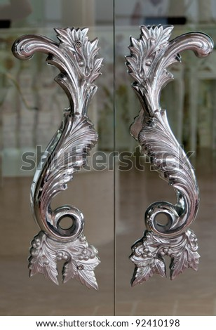steel handles on the glass on the doors - stock photo