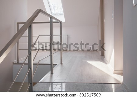 Steel handrail and marble stairs in luxurious modern house - stock photo