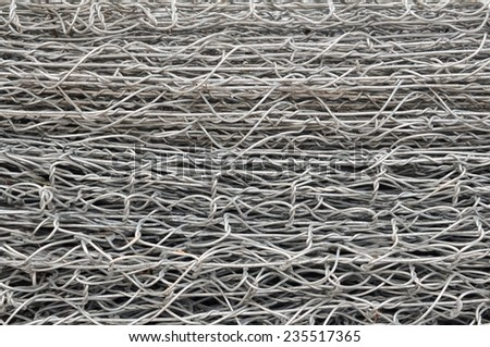 steel iron raw wire fence texture in a warehouse. - stock photo