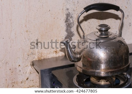 steel Kettle on stove - Dirty kettle - stock photo