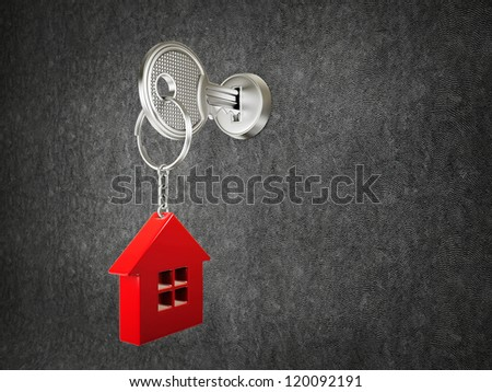 steel key and red house on a black background - stock photo
