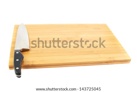 Steel kitchen chef's knife on the wooden cutting board isolated over white background