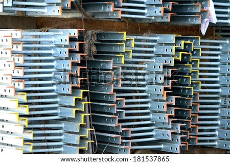 Steel ladder bunch on the rack in warehouse before shipment