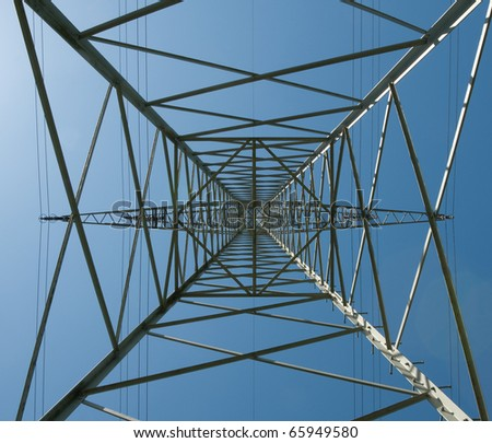 Steel lattice mast of a high voltage line - stock photo
