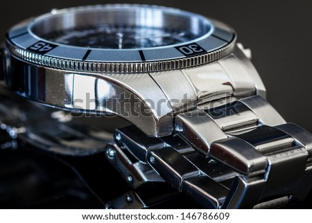 Steel luxury watch. Selective focus, shallow depth of field.