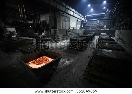 steel manufacturing plant, interior, poor light