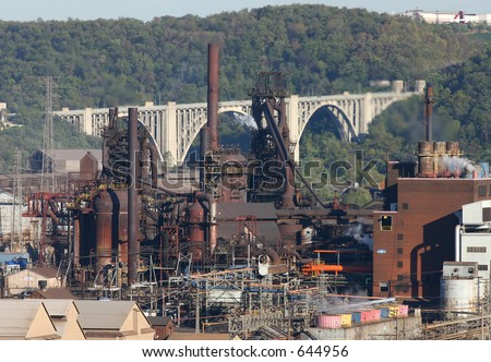Steel mill blast furnace. - stock photo