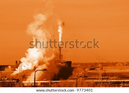 Steel mill emissions, monochrome, in an orange or rust tone - stock photo