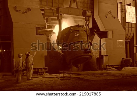 steel mills converter filling materials, closeup of photo  - stock photo