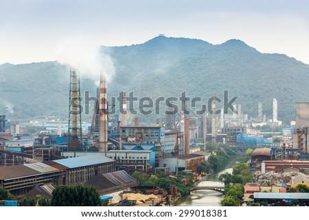 Steel mills hazy smoke pollution in industrial area - stock photo