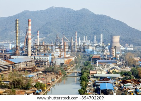 Steel mills Smoke and powder dust pollution in large industrial District - stock photo