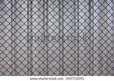 Steel net fence / Cross Pattern / Cross Fence background - stock photo
