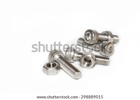 Steel nut and bolt on white background. - stock photo