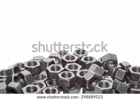 Steel nut pattern on white background. - stock photo