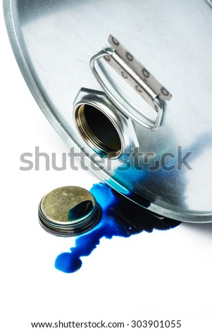 Steel oil and chemical drum over the white background with blue pollution liquid, isolated - stock photo