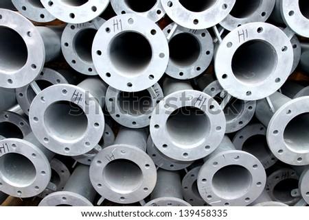 Steel pipes in warehouse - stock photo