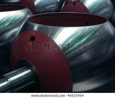 Steel piping knee, blue reflection - stock photo