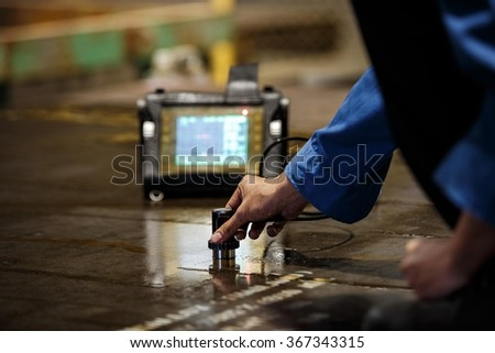 Steel plate inspection by ultrasonic test for found internal defect - stock photo