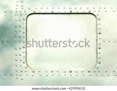 Steel plate with rivet - stock photo