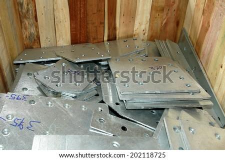 Steel plates bunch in wooden pallet - stock photo