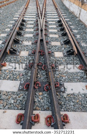 Steel railway tracks on the big station - stock photo