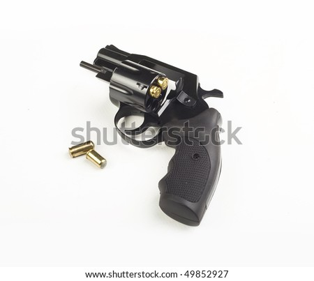 Steel revolver with an open drum and group yellow brass bullets 9 mm. Isolation on a white background - stock photo