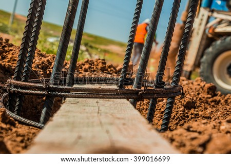 Steel rod used for poles construction with reinforce concrete in a hole in the ground at construction site. - stock photo