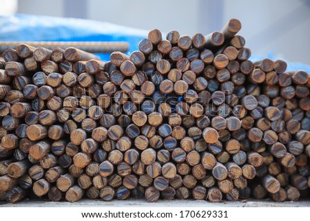 Steel rods or bars used to reinforce concrete, closeup - stock photo