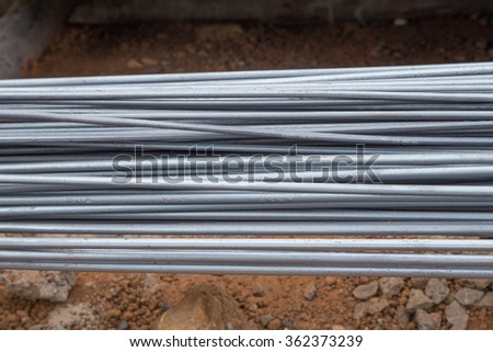 Steel rods or bars used to reinforce concrete for construction - stock photo