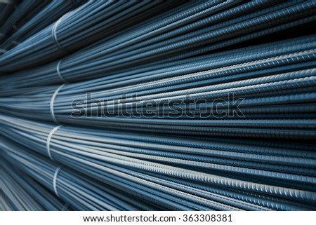 Steel rods or bars used to reinforce concrete. macro with shallow depth of field. background - stock photo