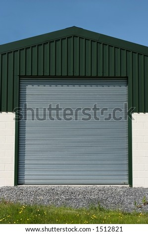 Steel roller shutter doors on a new constructed barn.