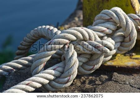 Steel rope tie white - stock photo
