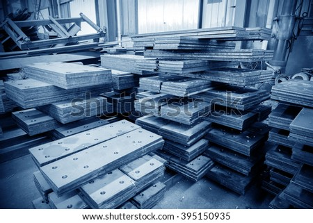 Steel semi-finished steel factory, blue tone image. - stock photo