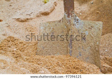 steel shovel on sand - stock photo