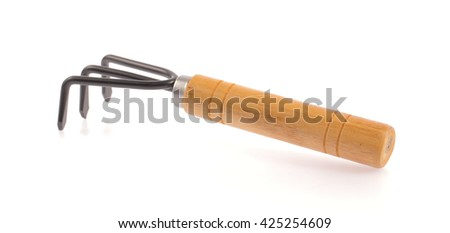 Steel shovel with a wooden handle isolated on a white background.