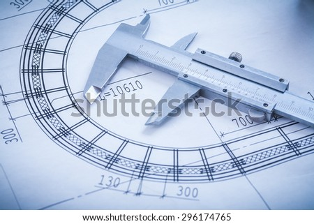 Steel slide caliper on blueprint horizontal version construction concept. - stock photo