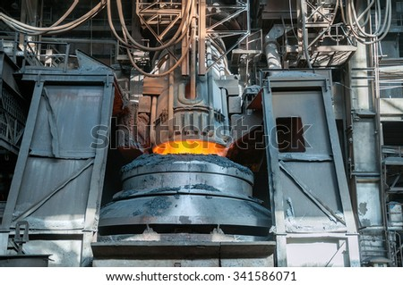 steel smelting in furnace - stock photo