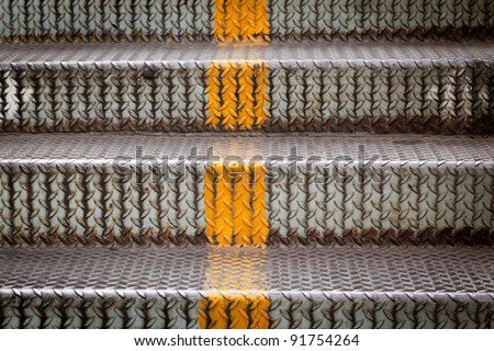 steel stairs with yellow line for separated up or down - stock photo