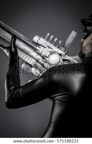 Steel.Starfighter with huge plasma rifle, fantasy concept, military helmet and goggles motorcyclist