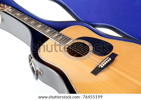 Steel string acoustic guitar, inside an open case. isolated on white. - stock photo