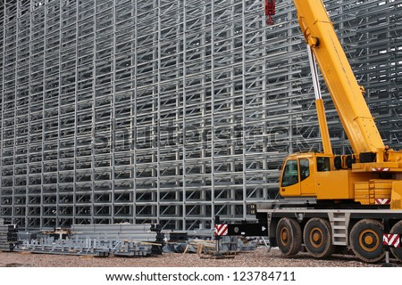 Steel structure of a high rack warehouse and a crane during construction