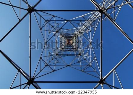 steel structure of antenna mast under sky - stock photo
