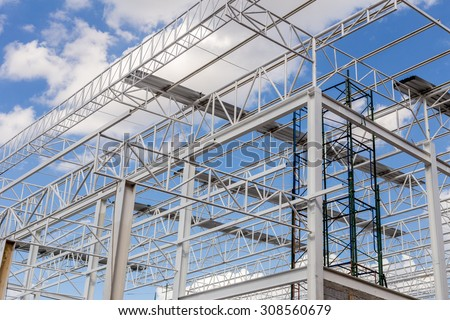 Steel Structure Under Construction with Blue Sky Background - stock photo