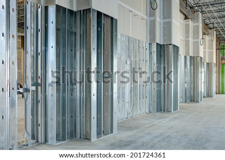 steel studs used to frame in a large commercial building with drywall covering